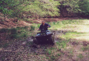 This is me coming out of the pit on my Suzuki King Quad....